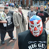 "newburyport: Wrestlers ""Big Gun"" Jim Sargent with Bugsy Stone, Big Woody, Champaigne"" Joe Moakley,  Daryl Mitchell, Ed Hunt, , Ace Adams,and The Hampton Beach Bad Boy, behind him  in Markey Square in Newburyport. They will be wrestling at Yankee Homecoming. Jim Vaiknoras/staff photo"