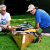 amesbury: Aims Corey and J J Cote go over their equiptment at the inaugural Lake Gardner Canoe-O Canoe, Kayak and SUP Orienteering Adventure Race Saturday. Jim Vaiknoras/staff photo