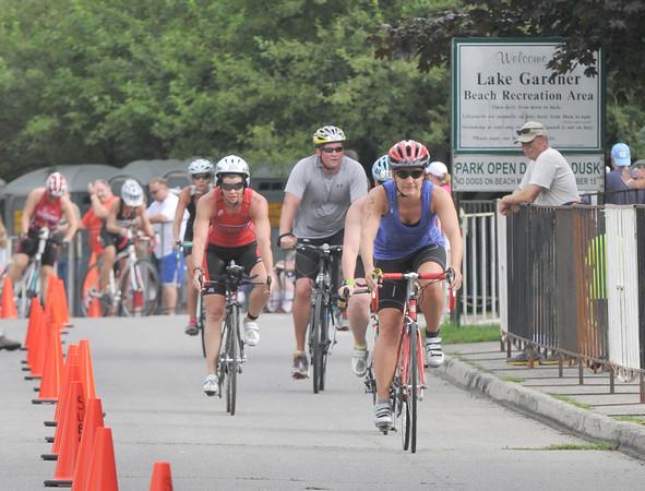 Amesbury: Cyclist head out during the Dam Triathlon Saturday morning in Amesbury. Jim Vaiknoras/staff photo