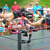 "Newburyport: Atlantic Pro Wrestler the International Super Star flies off the ropes at Mark ""The Sure Thing "" Shurman during their match at Old Fashioned Sunday. Jim Vaiknoras/staff photo"