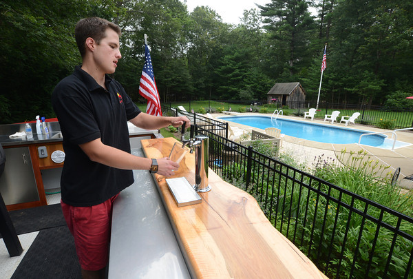 Rowley: Chris Breen, owner of Que N' Brew pours a beer from his mobil beer tap/BBQ/ Smoker in Rowley. Jim Vaiknoras/staff photo