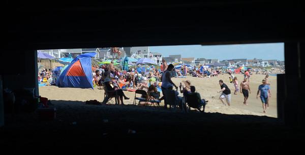JIM VAIKNORAS/staff photo A very crowded Salisbury Beach on a warm sunny Fouth of July Weekend.