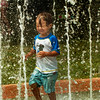 BRYAN EATON/Staff photo. Kai Waselchuck, 3, of Seabrook cools off at the water playground at Amesbury Town Park on Thursday afternoon.