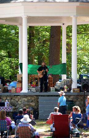 JIM VAIKNORAS/staff photo Amesbury resident Eryk Fairchild performs just before the Auction Under the Pines in Amesbury Monday. Proceeds from the event benifited the Bartlett Museum.