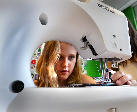 BRYAN EATON/Staff photo. Olivia Hansen, 11, learns stitching on a sewing machine at the Newburyport Rec Center on Monday. Susan McIntire is teaching the week-long course for Newburyport Youth Services, a new addition for this year's Summer Program activities.