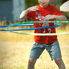 BRYAN EATON/Staff photo. Sam Parr, 6, and others try out the skills at hula hoops at Perkins Playground in Newburyport on Wednesday morning. They were in the Newburyport Youth Services Department Summer Camp doing all kinds of different activities at the south end playground.