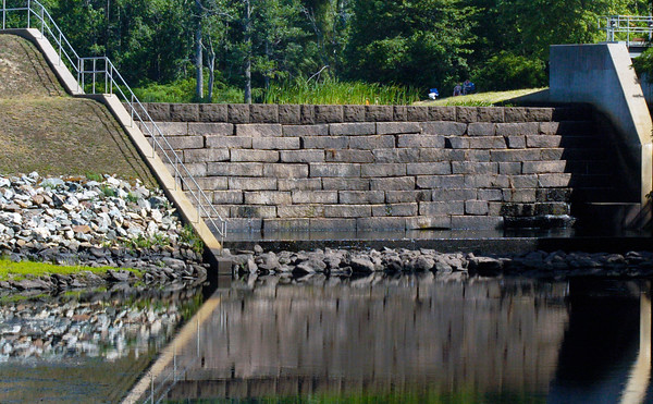 BRYAN EATON/Staff photo. There's barely a trickle of water over the dam at Lake Gardner in Amesbury as the drought continues. Some relief came to farmers and gardners with heavy downpours Monday afternoon.