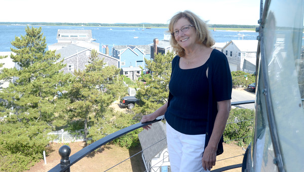 JIM VAIKNORAS/Staff photo Getting Aquainted with Linda Collins at top the Plum Island Light house.