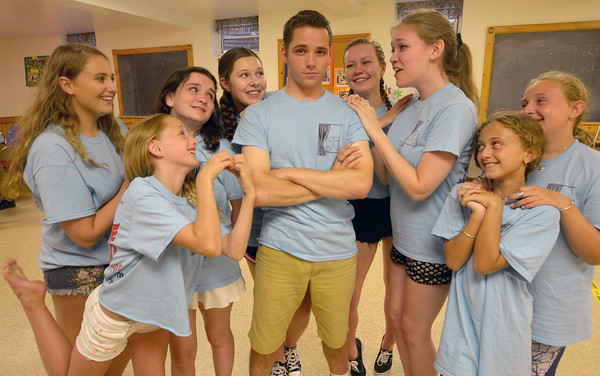 "JIM VAIKNORAS/staff photo Josef Allen as Conrad Birdie surrounded by his adoring fans during a Center Stage Theatre Company reaherses for ""Bye Bye Birdie"" performances will be at the  Byfield Community Arts Center on July 29 and 30 at 7 p.m. and July 31 at 2 p.m."