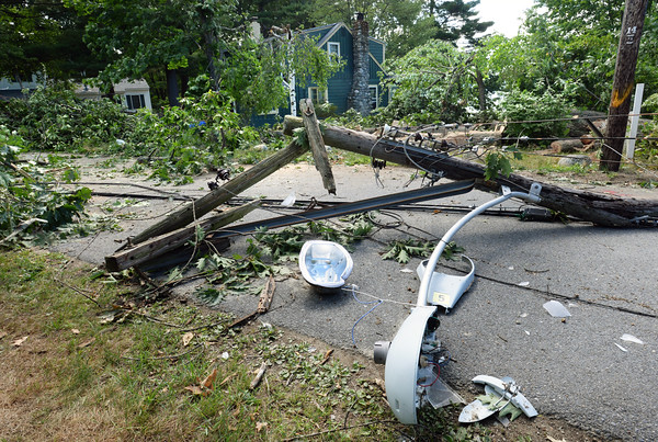 BRYAN EATON/Staff photo. This utility pole was blown down taking the wires with it.