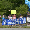 JIM VAIKNORAS/staff photo About two dozen people turned out for a rally in support of the police at Atkinson Common in Newburyport Saturday morning.