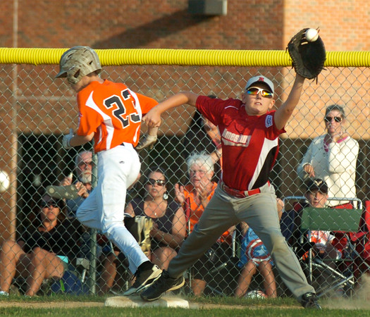 BRYAN EATON/Staff photo. Beverly's #23 gets by Amesbury first baseman #13.