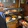 BRYAN EATON/Staff photo. Hari Khanal, new owner of Mr. India, is working to bring his family to Newburyport from Chicago.