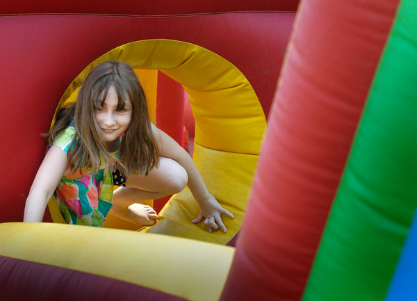 BRYAN EATON/Staff photo. Brianna Traversy, 9, of Amesbury runs through the bouncy obstacle course at Amesbury Days' Kids Day in the Park.