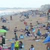 JIM VAIKNORAS/staff photo Crowds fill Salisbury Beach as the 4th of July weekend draws near.