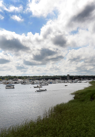 BRYAN EATON/Staff photo. Mixed clouds appear over the Merrimack River in a view from Ring's Island in Salisbury as several rain showers came through the area on Thursday afternoon. The weekend looks sunny with little chance of rain.