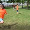 BRYAN EATON/Staff photo. Younsters enrolled in the Merrohawke Nature Camp unwind with a game of team tag on Newburyport's Waterfront Park yesterday. They had been out on the ocean pulling lobster traps and then fishing for flounder.
