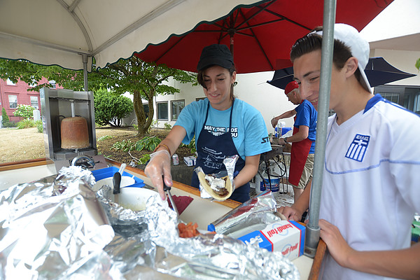 JIM VAIKNORAS/Staff photo Malina Popescu and Chris Connor serve Gyros at the annual Greek Food Festival at the Greek Church on Harris Street in Newburyport.