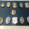 JIM SULLIVAN/Staff Photo. Display of Amesbury Police badges on display at the department.