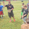 JIM VAIKNORAS/Staff photo Jamie Mroz encourages kids at the Amesbury Sports Clinic at Amesbury High School Sunday. Jamie worksa for the Cleveland Browns.