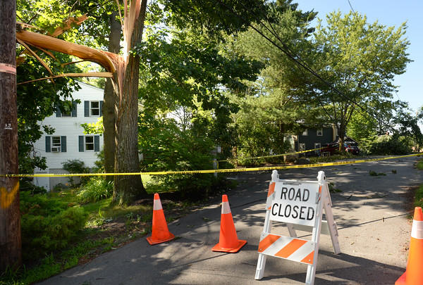 BRYAN EATON/Staff photo. The end of Birchmeadow Road in Amesbury remained closed with downed power lines as utility crews worked on the other end of the road.