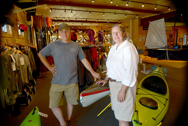 JIM VAIKNORAS/staff photo Micheal Duffielt and Sandy Gilbert of The Kayak Center in Newbury. Kayaking and paddle boading will be part of this years Yankee Homecoming.