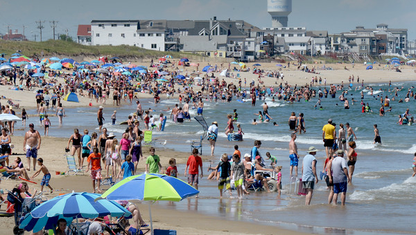 BRYAN EATON/Staff photo. Salisbury Beach was a good place to be yesterday as an onshore breezed cooled bathers as well as the Atlantic Ocean which was 68 degrees. Relief is on the way with possible rain and a cooler temperature today.