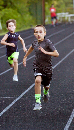BRYAN EATON/Staff photo. Drew Alsup, 8, of West Newbury is the winner in this heat of the 100 meter dash in River Rivals.