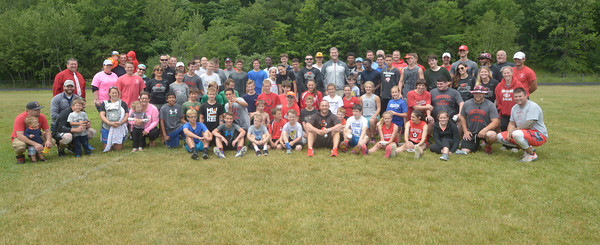 JIM VAIKNORAS/Staff photo Kids and coaches at the Amesbury Sports Clinic put on by NFL employee and native Jamey Mroz at Amesbury High School Sunday.