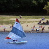 BRYAN EATON/Staff photo. A sailboat moves offshore from bathers at Lake Gardner Beach in Amesbury during Wednesday's stellar weather. Thursday is to be a repeat, but the weekend gets hotter and muggier.