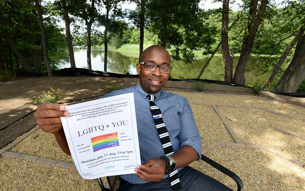 BRYAN EATON/Staff photo. Rev. Ogun Holder in the new mediation garden at Unity on the River. The Amesbury church is reaching out to the LGBTQ community.