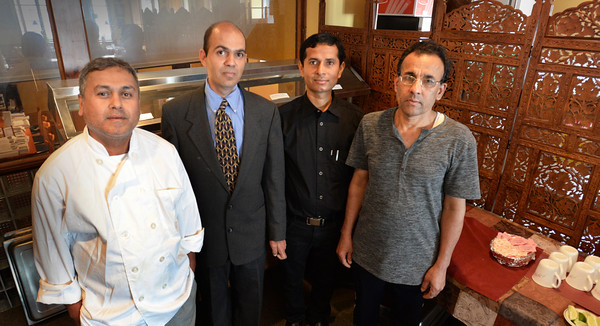 BRYAN EATON/Staff photo. Hari Khanal, new owner of Mr. India, second from left, with his staff, chef Ganesh Bista, left, Damodar Panthi and Surya Chaulagy, right.