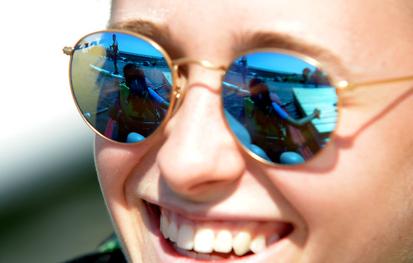JIM VAIKNORAS/staff photo Zoe Duffielt , 17 on the paddle board and Rayna Duffielt,17,in a kayak are reflected in the sun glasses of  Olivia Kubaska, 18 in the Parker River in Newbury. Kayaking and paddle boading will be part of this years Yankee Homecoming.