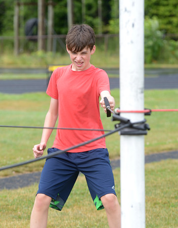 JIM VAIKNORAS/Staff photo Zachary Rinaldi, 14, does a wieght tranning excercise  at the Amesbury Sports Clinic put on by NFL employee and native Jamey Mroz at Amesbury High School Sunday.
