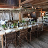 BRYAN EATON/Staff photo. The barn is set up for rustic dining.