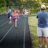 BRYAN EATON/Staff photo. Spectators photograph one heat of the girls 100 meter dash.