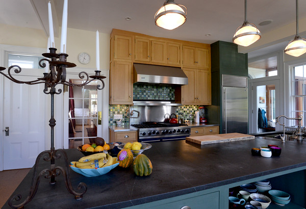 BRYAN EATON/Staff photo. The large kitchen with an island in the center.