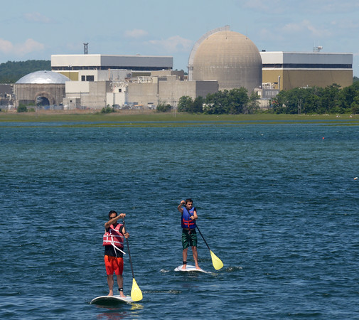 JIM VAIKNORAS/staff photo Two stand up paddle boards make their way across in Seabrook Sunday morning.