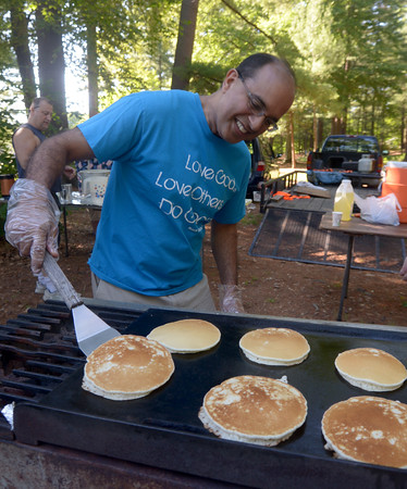 JIM VAIKNORAS/staff photo Hareave Dhaliwal of Plastow NH  flips the flapjacks at the annual Pancakes Under the Pines in Amesbury Monday.