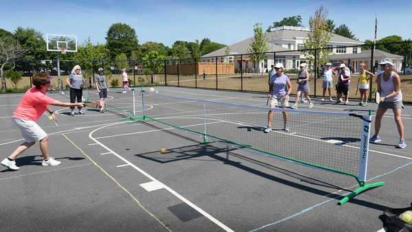"""BRYAN EATON/Staff photo. The Newburyport Council on Aging has started to teach """"pickleball"""" at the Senior Center on Wednesday mornings. A paddle sport created for all ages and skill levels, the game is a fun sport that combines many elements of tennis, badminton and ping-pong."""