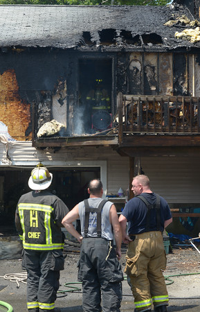 JIM VAIKNORAS/Staff photo Fire damage at the back of a home on CCC road in Salisbury.