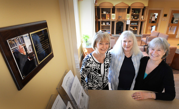 BRYAN EATON/Staff Photo. Under a plaque of Joseph Lyons, from left, Eleanor Lyons, Karen Murphy and Jane Baird at the Newburyport Senior Center.