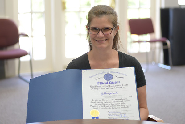 JIM VAIKNORAS/staff photo West Newbury Coucil on Aging Director Theresa Woodbury with her citation from the State Senate.