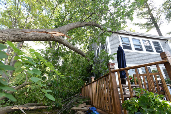 BRYAN EATON/Staff photo. A downed tree rests on this home at 2 Star Lane.