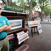 BRYAN EATON/Staff photo. John William Brown is on a committee that worked to bring more local vendors and local artists in locations on Inn Street during Newburyport's Yankee Homecoming as opposed to out of town vendors and sales displays.