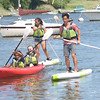 JIM VAIKNORAS/staff photo Max ,16, and Zoe Duffielt , 17 on the paddle board and Rayna Duffielt,17, and Olivia Kubaska, 18 in the kayak make their was around the Parker River in Newbury. Kayaking and paddle boading will be part of this years Yankee Homecoming.