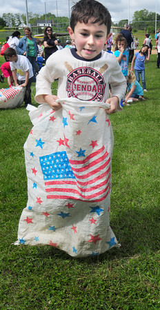 Amesbury: Michael Abel, 6, jumps in the Sack Races at Amesbury's Cashman School Field Day on Wednesday with kindergarten through second-graders competing. Thursday, the third and fourth-graders will compete in their games. Bryan Eaton/Staff Photo