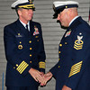Newburyport: Capt. John C. O'Connor III, left, congratulates Mark W. DiLenge, new officer in charge of Coast Guard Station Merrimack River as he assumed the new position in a ceremony yesterday. Bryan Eaton/Staff Photo