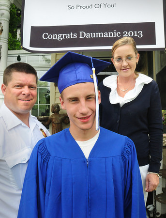 Seabrook: Dauminic Fucile, shown with his stepfather and mother, Koko and Amy Perkins graduated from Winnacunnet High School last night. His mother was diagnosed with an aggressive type of brain cancer in October that's already returned once. Her dream was to make sure she saw her son graduate which she did last night. Bryan Eaton/Staff Photo