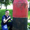 Newburyport: US Coast Guardsman BM2 Justin Herring removes rust from the Nun Buoy at Newburyport's Waterfront Park on Monday before repainting. Bryan Eaton/Staff Photo